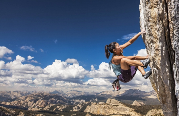 https://www.shutterstock.com/pic-415024942/stock-photo-female-climber-dangles-from-the-edge-of-a-challenging-cliff.html
