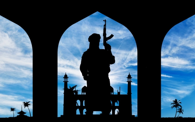 https://www.shutterstock.com/pic-340068836/stock-photo-concept-of-terrorism-silhouette-of-a-terrorist-with-a-weapon-on-the-background-of-the-town-hall.html?src=fCigynCgZz0-Fzo85q23GQ-1-9