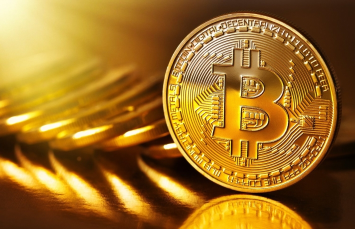 https://www.shutterstock.com/image-photo/golden-bitcoins-on-gold-background-photo-549334807