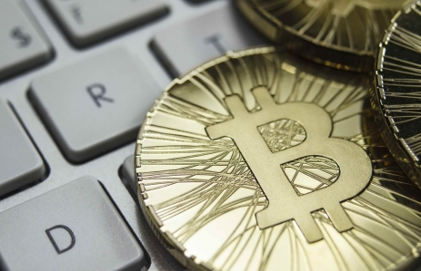 https://www.shutterstock.com/image-photo/shiny-gold-bitcoin-coin-laying-on-584233300