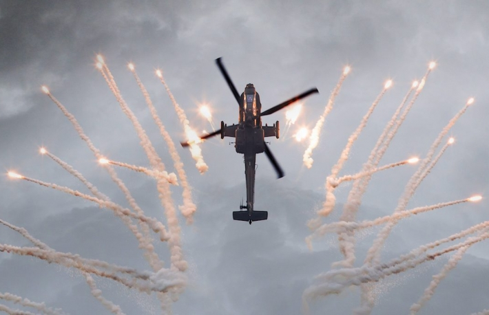 https://www.shutterstock.com/image-photo/silhouette-attack-helicopter-firing-flares-storm-443355100?src=Z-t6kjZNtytPTTrZjL2SPw-1-48