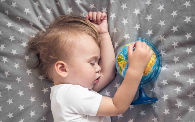 https://www.shutterstock.com/image-photo/sleeping-baby-holding-globe-his-hands-454457683