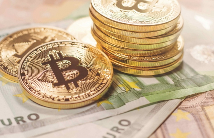 https://www.shutterstock.com/image-photo/golden-bitcoin-euro-background-cryptocurrency-600687461