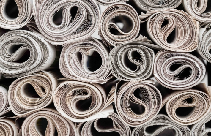 https://www.shutterstock.com/image-photo/stack-newspapers-rolls-paper-texture-background-378529600