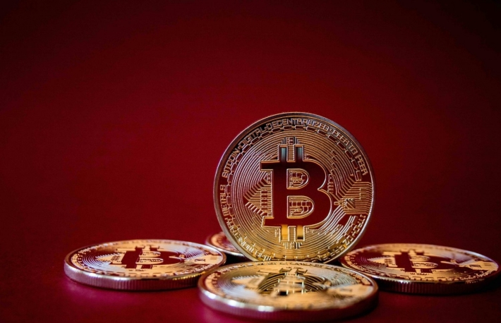 https://www.shutterstock.com/image-photo/golden-bitcoins-on-red-background-trading-562929226