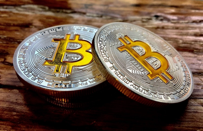 https://www.shutterstock.com/image-photo/cryptocurrency-physical-two-silver-bitcoin-coins-632711600