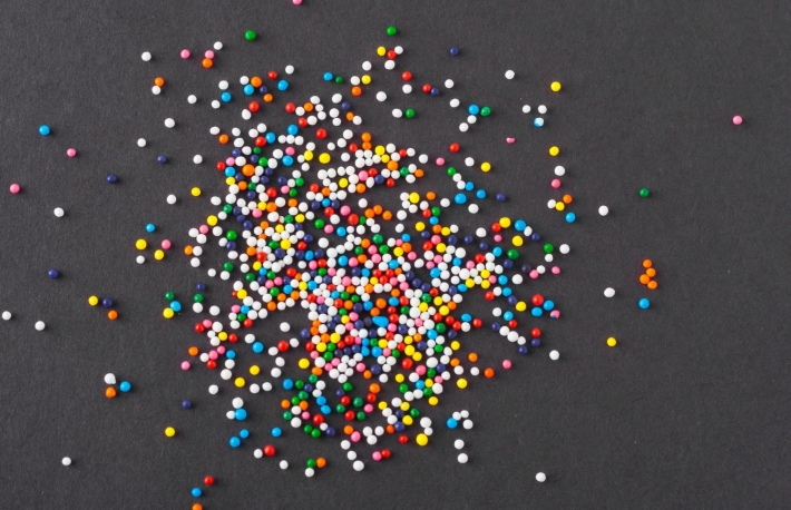 https://www.shutterstock.com/image-photo/colorful-sprinkles-spilled-on-black-textured-265182164