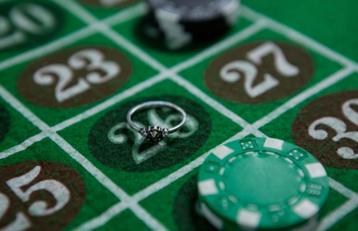 https://www.shutterstock.com/image-photo/closeup-ring-chips-on-roulette-table-674418517
