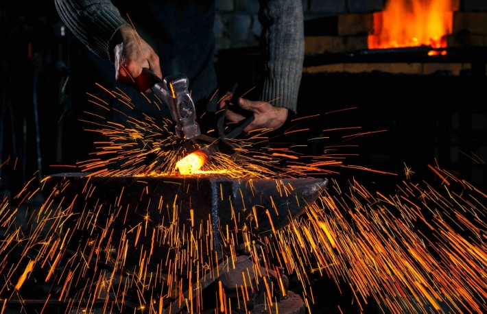 https://www.shutterstock.com/image-photo/blacksmith-manually-forging-molten-metal-on-571260994