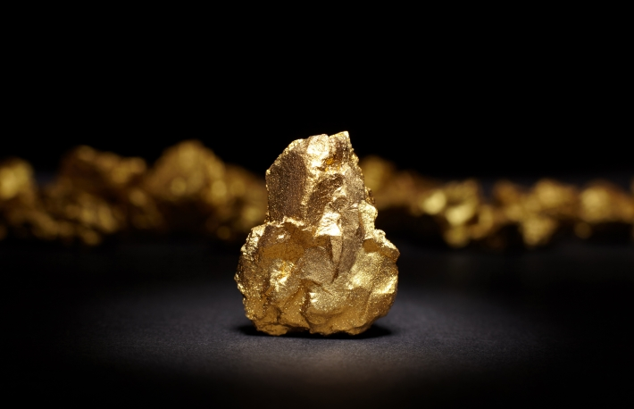 https://www.shutterstock.com/image-photo/closeup-big-gold-nugget-on-black-484553362