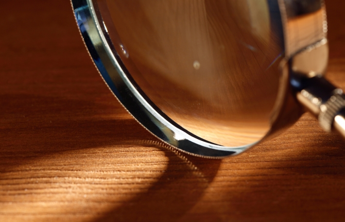 https://www.shutterstock.com/image-photo/extreme-closeup-magnifying-glass-standing-on-69822919?src=library