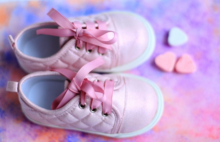 https://www.shutterstock.com/image-photo/pink-baby-girl-first-sneakers-shoes-599673587