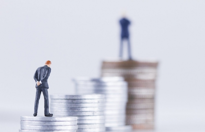 https://www.shutterstock.com/image-photo/miniature-business-man-standing-on-coin-700205251
