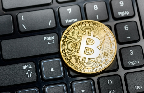 https://www.shutterstock.com/image-photo/bitcoin-coin-on-black-keyboard-background-678506725