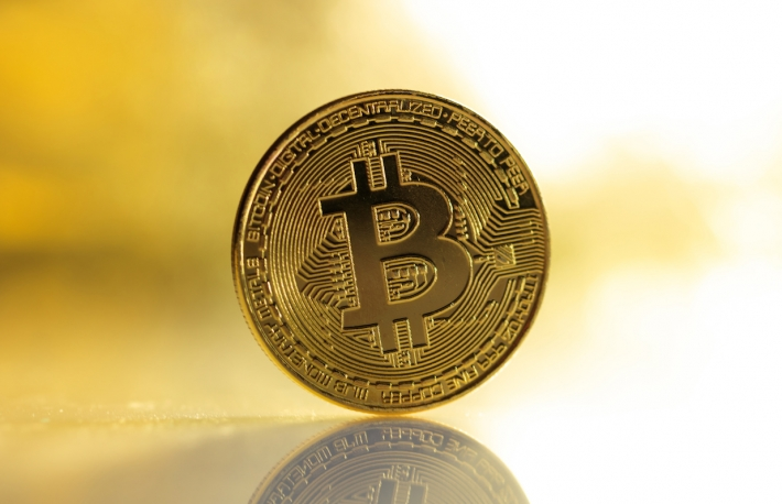 https://www.shutterstock.com/image-photo/cryptocurrency-concept-single-golden-bitcoin-reflection-723942598?src=rRyLUGtx_eLkH7ApV_QYZw-1-52