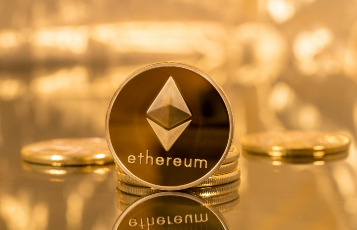 https://www.shutterstock.com/image-photo/stack-ether-coins-ethereum-on-gold-662800042
