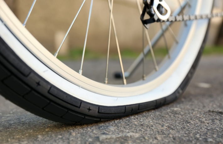 https://www.shutterstock.com/image-photo/closeup-view-bicycle-flat-tire-on-645504883