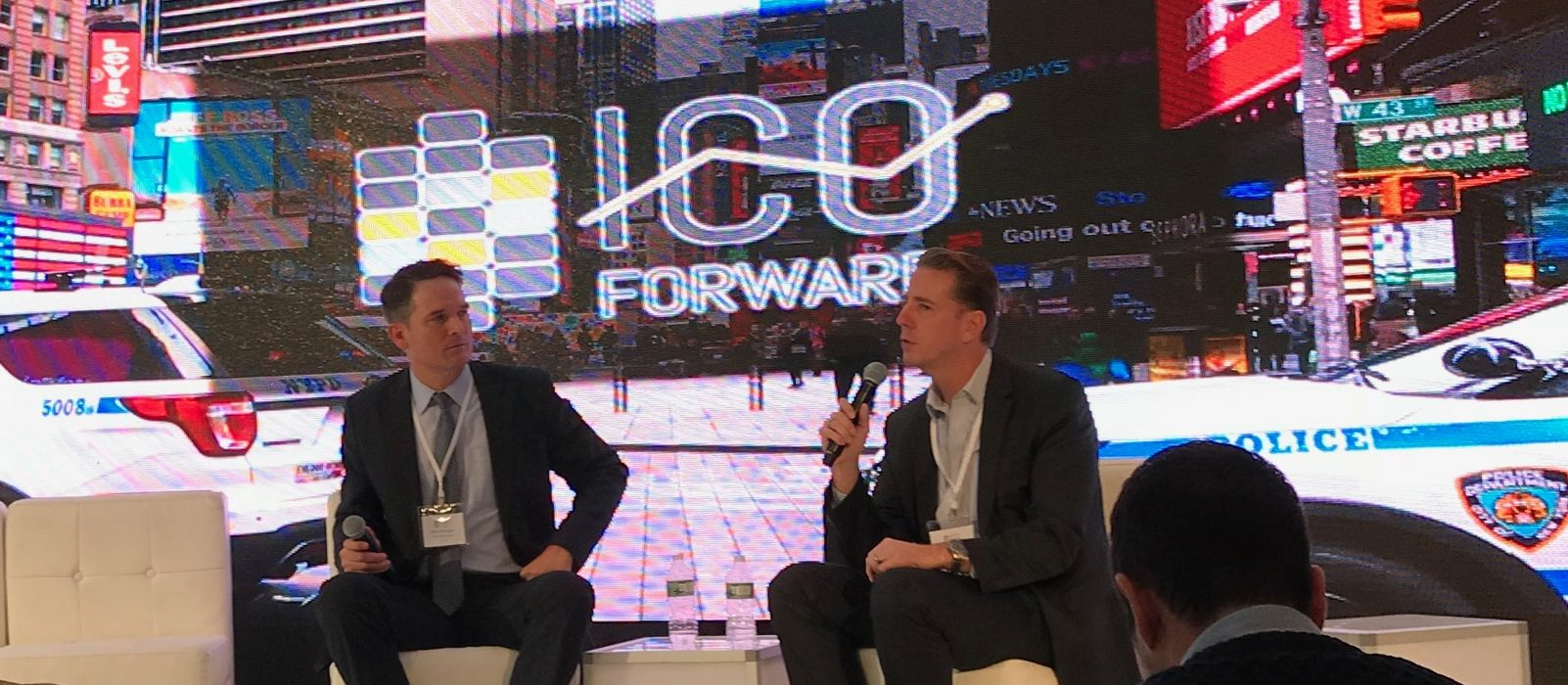 Nick Morgan, attorney at Paul Hastings, and R. Scott Forston, of S&P Global's compliance team, converse on stage at ICO Forward Photo by Brady Dale.