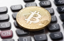 https://www.shutterstock.com/image-photo/golden-bitcoin-coin-on-calculator-close-581394274