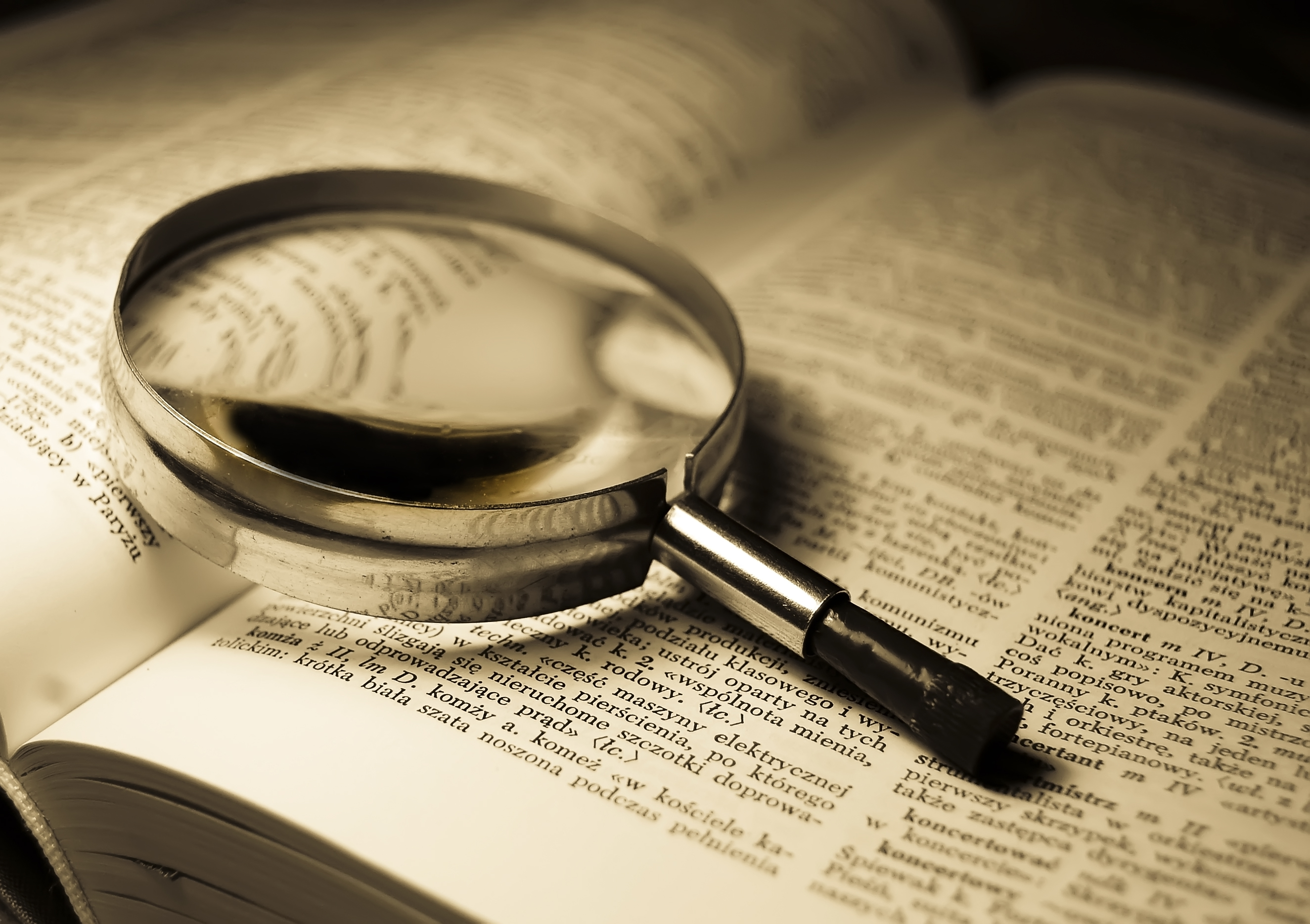 dictionary, magnifying glass