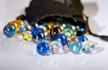 https://www.shutterstock.com/image-photo/closeup-on-many-colorful-glass-marbles-60751024