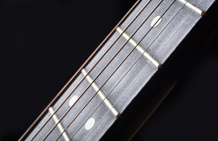 https://www.shutterstock.com/image-photo/closeup-wooden-guitar-neck-fretboard-tensioned-775579132?src=H8Zn3YTBgdfvTZkgsBqhsQ-1-61