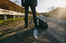 https://www.shutterstock.com/image-photo/man-hitchhiking-on-country-road-traveler-530155426