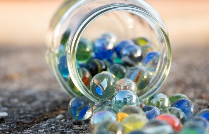https://www.shutterstock.com/image-photo/glass-jar-full-marbles-fallen-on-667616539?src=vMFB7OKza1fWCxmuRJ5DdQ-2-46