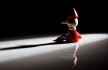 https://www.shutterstock.com/image-photo/pinocchio-doll-on-black-background-shadow-774172408?src=umJpLDpdVyr8qs4tXoF4TA-1-16