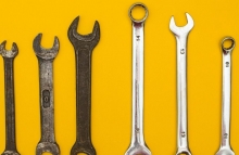 https://www.shutterstock.com/image-photo/old-new-wrenches-on-yellow-background-557375263