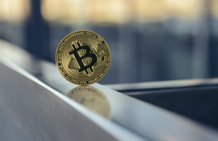 https://www.shutterstock.com/image-photo/golden-bitcoin-standing-on-metal-handrail-746479486