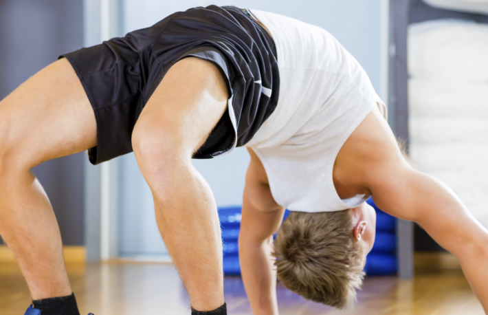 https://www.shutterstock.com/image-photo/man-performing-backbend-pose-on-mat-686791597