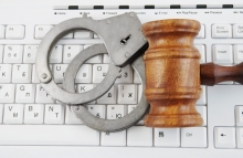https://www.shutterstock.com/image-photo/gavel-handcuffs-on-white-computer-keyboard-146682707