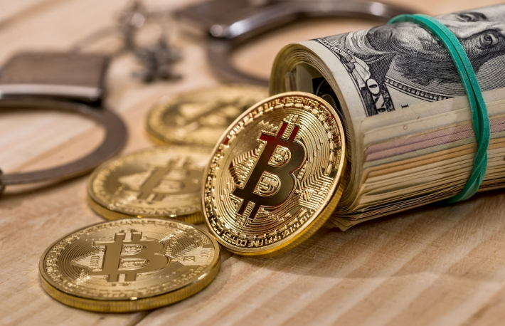 https://www.shutterstock.com/image-photo/handcuff-dollar-bitcoin-close-781734958?src=ltTNBeKl6eL5yix5kdFsGQ-1-11