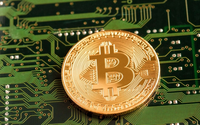 https://www.shutterstock.com/image-photo/golden-bitcoin-cryptocurrency-on-computer-circuit-716505295