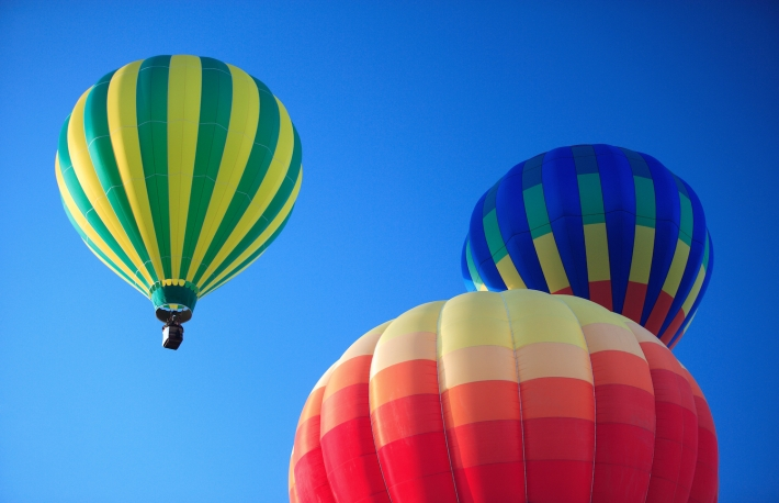 "<em><a href=""https://www.shutterstock.com/image-photo/colorful-bouncing-balls-outdoors-against-blue-1009338745?src=kX40acVQD5j7t-pxulVdHQ-1-48"">Balloons photo</a> via Shutterstock.</em>"