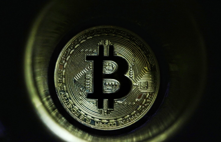 https://www.shutterstock.com/image-photo/golden-bitcoin-shadow-on-black-background-722195572