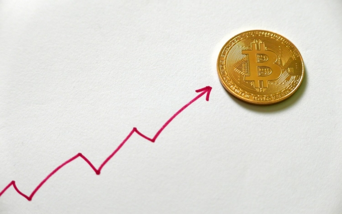 https://www.shutterstock.com/image-photo/golden-bitcoin-replica-on-white-paper-1035505159