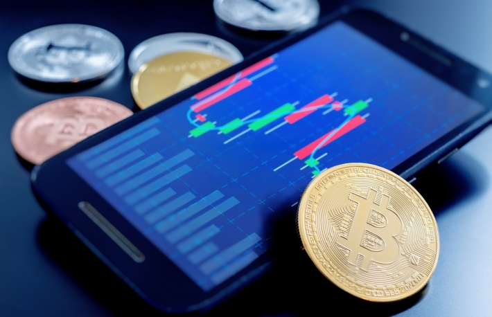 https://www.shutterstock.com/image-photo/cryptocurrency-coins-next-cell-phone-showing-1036519195?src=8_OizliVKFiwXqT4FheEFw-3-2