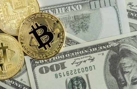 https://www.shutterstock.com/image-photo/golden-bitcoin-coin-on-us-dollars-1076933585?src=JrXTV1RFreMDDDLbL9lOfQ-1-25