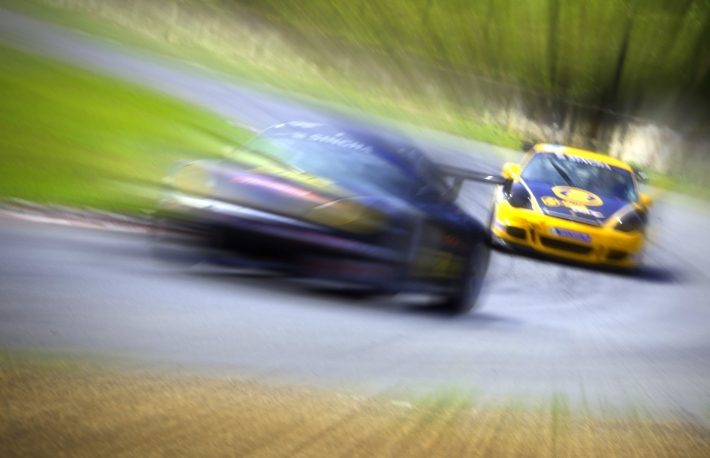 https://www.shutterstock.com/image-photo/radial-blur-racing-car-track-152537309