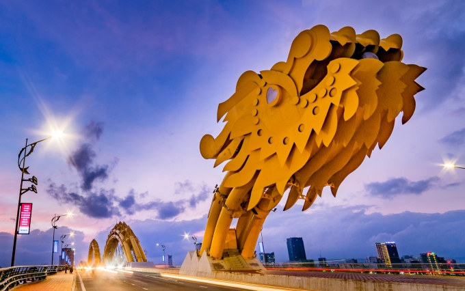 "<em><a href=""https://www.shutterstock.com/image-photo/da-nang-city-vietnam-4-november-509967826"">Dragon bridge in Vietnam photo</a> via Shutterstock.</em>"
