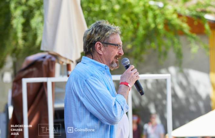 John McAfee on a CoinsBank luxury cruise.