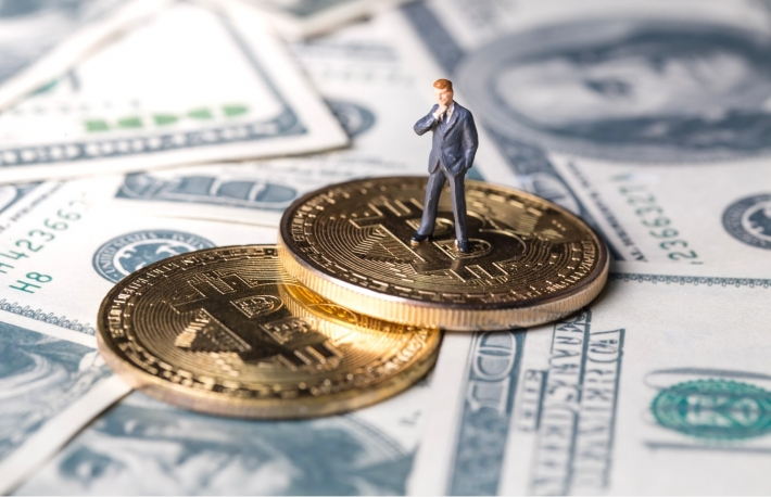 https://www.shutterstock.com/image-photo/miniature-figurine-toys-standing-on-bitcoin-1065137105?src=h2Ympk6RR7278J9fwPTw6A-1-47