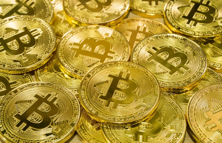 https://www.shutterstock.com/image-photo/physical-bitcoin-pile-background-cryptocurrency-trading-1008607573