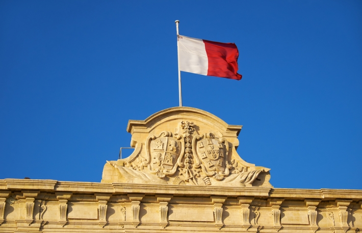 https://www.shutterstock.com/image-photo/decoration-topped-maltese-flag-on-roof-605411189