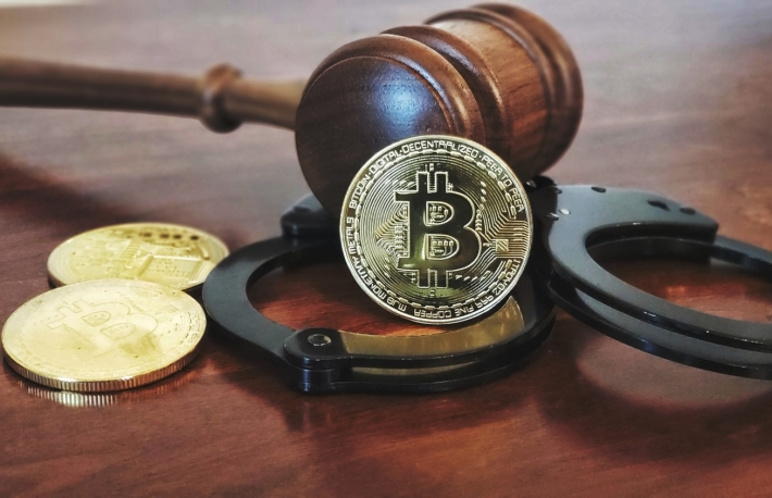 https://www.shutterstock.com/image-photo/gavel-handcuffs-bitcoins-on-wooden-desk-1077112922?src=j3SW9x7OJ1nVtfbENgiUxw-1-4