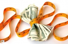 https://www.shutterstock.com/image-photo/tape-measure-pulled-tightly-around-money-2824985