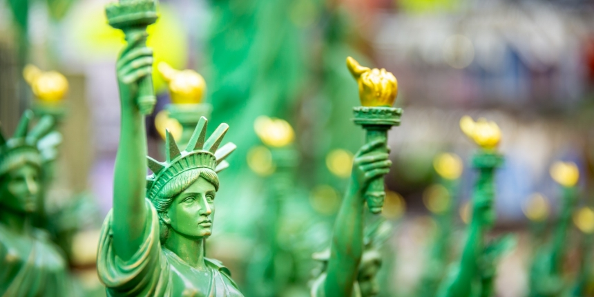 "<em><a href=""https://www.shutterstock.com/download/confirm/1115626937?src=l6L2LWZvShMqUW0hkXYd9g-1-38&size=huge_jpg"">Statue of Liberty miniatures photo</a> via Shutterstock</em>"