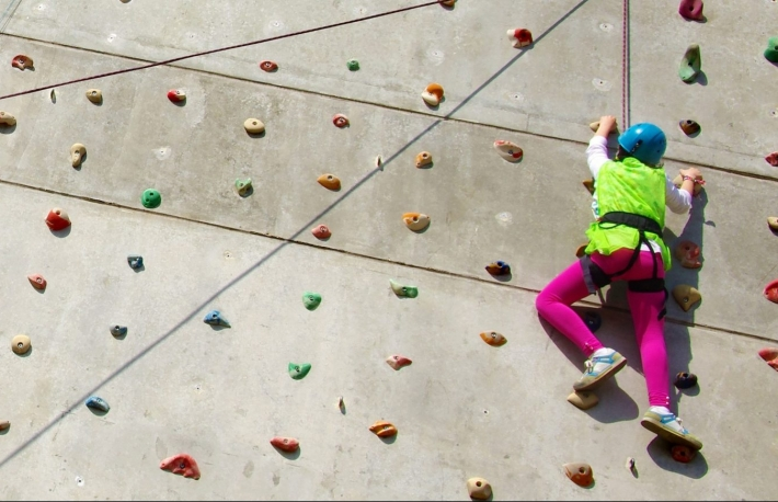 https://www.shutterstock.com/image-photo/youngsters-effort-climbing-wall-reach-top-272807588